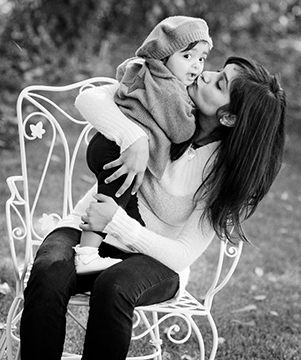 mom kissing child bw
